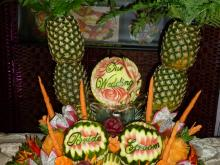 palm trees fruit carving wedding display